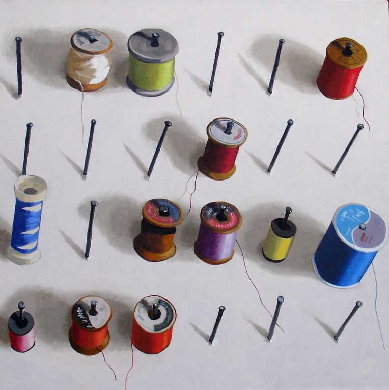 Cotton reels, spools of thread on a board
